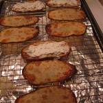 Baked potato slices, with the first cheese layer.