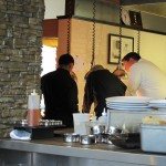 Chef and servers huddle to work out the plan.
